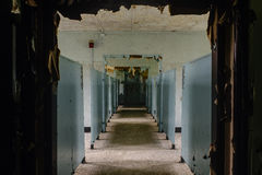 Hallway - Abandoned Hospital / Sanitarium - New York. An interior view of a hallway inside an abandoned hospital in New York stock images