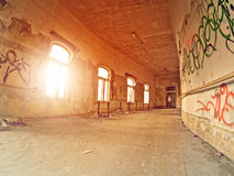 Hallway. In an abandoned industrial complex with graffiti on the walls Stock Image