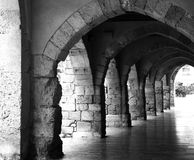 Hallway of Arches. A black and white image of an outdoor hallway made of stone arches in the town of Tarragona Spain Royalty Free Stock Images