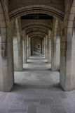 Hallway of Arches in Urban Church Garden. A hallway made up of arches surrounds a quiet urban garden royalty free stock images