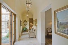 Hallway With Artwork And Armchair Stock Photos