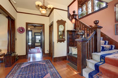 Hallway with brown trim and hardwood floor in old house. Stock Photos
