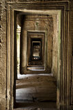 A Hallway at Cambodia's Angkor Thom temple complex. A view down a hallway at Cambodia's Angkor Thom temple complex Royalty Free Stock Image