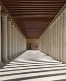 Hallway and columns in Athens, Greece. A long hallway or passageway with classic columns on either side. Athens, Greece Royalty Free Stock Images