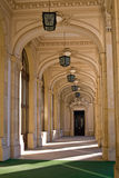 Hallway corridor. A neoclassical corridor with lights and shadows Royalty Free Stock Image