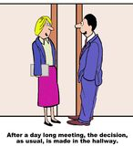 Hallway Decision. Cartoon of two business leaders making the decision in the hallway, even though they spent the day in a meeting together Royalty Free Stock Photo