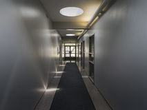 Hallway with Direct and Indirect Light. Vanishing point perspective of hallway with direct sunlight via skylights and indirect artificial lighting Stock Photography
