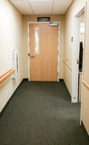 Hallway and door leading to lobby in office building Royalty Free Stock Image