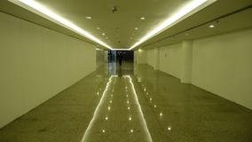 Hallway with the floor reflection. Simple and clean hallway with the floor reflection and lights Royalty Free Stock Images