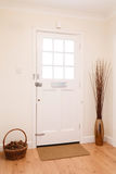 Hallway and front door. Contemporary hallway in a house with a white front door Royalty Free Stock Photos