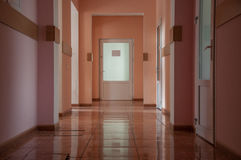 Hallway in a hospital at warm colors royalty free stock photography
