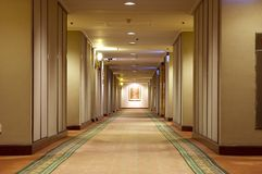 Hallway in hotel. Typical hallway inside hotel. Bright hall with simple decoration and carpet Stock Photo