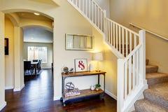 Hallway interior in beige tones and deep brown hardwood floor. Stock Photography