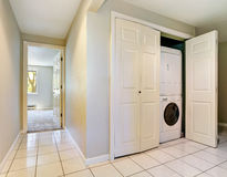 Hallway interior with built-in laundry appliances Royalty Free Stock Photos