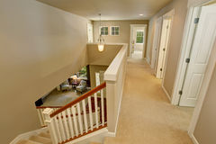 Hallway interior with carpet floor and beige walls Royalty Free Stock Photo