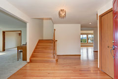 Hallway interior with hardwood floor. View from opened front door. Stock Images