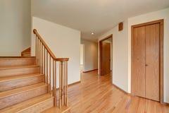 Hallway interior with hardwood floor. View of wooden stairs. Stock Photo