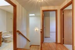 Hallway interior with hardwood floor. View of wooden stairs. Stock Image