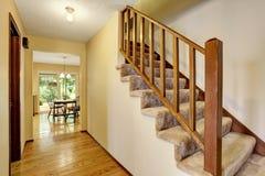 Hallway interior in light tones with hardwood floor. View of carpet floor Stock Photos
