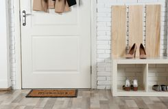 Hallway interior with shoe rack and mat. Near door royalty free stock photos
