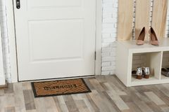 Hallway interior with shoe rack and mat. Near door stock photos