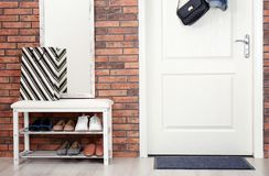 Hallway interior with shoe rack, mirror and mat. Near door stock photography