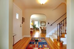 Hallway with large staircase and dinign room Royalty Free Stock Images