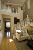 Hallway and living room. Mansion staircase , hallway and living room with luxurious decor Stock Photography