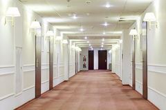 Hallway with many doors leading into hotel rooms. Stock Photos