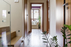 Hallway in modern house. Wooden stylish hallway with wooden stairs in modern big house royalty free stock photo