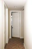 Hallway with open door Stock Images