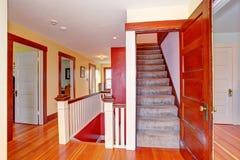 Hallway with open door to upstairs Stock Photo