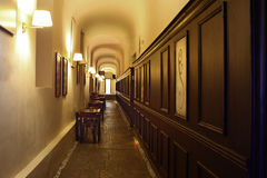 Hallway. Pub hallway with wooden wall and lamps Royalty Free Stock Photography
