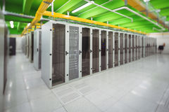 Hallway with a row of servers. In server room Stock Photography