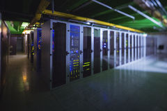Hallway with a row of servers. In server room Stock Photos