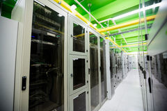 Hallway with a row of servers. In server room Stock Photo