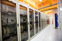 Hallway with a row of servers. In server room Royalty Free Stock Images