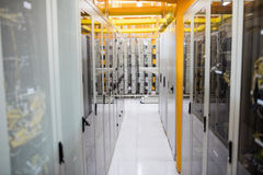 Hallway with a row of servers. In server room Stock Images