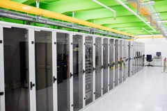 Hallway with a row of servers Stock Image