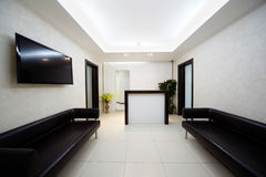 Hallway in salon with leather divans Stock Image