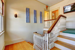 Hallway with staircase. Hallway with hardwood floor and staircase Royalty Free Stock Photography