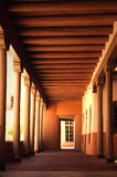 Hallway with Vigas. Outdoor walkway with wooden pillars and vigas found in a traditional adobe building in New Mexico Stock Image