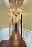 Hallway wih chandeliers. Hallway with chandeliers in luxury suburban home Stock Photo