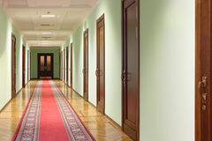 Hallway wit wood doors Royalty Free Stock Photos