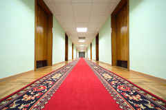 Hallway with wood doors, end of corridor Stock Photos