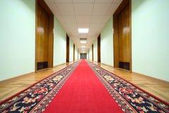 Hallway with wood doors, end of corridor Stock Photos