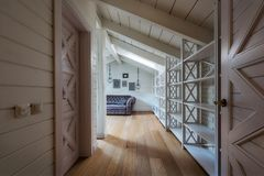 Hallway with wooden doors and walls in modern. Country house stock image