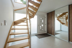 Hallway with wooden stairway Stock Image