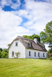 Halmtäckt hus i Irland Arkivfoto