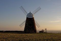 Halnaker Windmill. Is a tower mill which stands on Halnaker Hill, northeast of Chichester, Sussex, England. Image taken on a very cold winter afternoon Royalty Free Stock Image